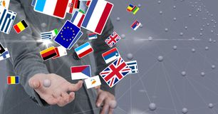 Midsection of business person with various flags stock photo