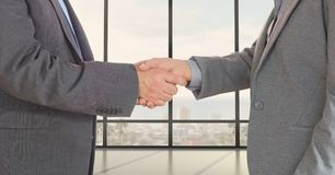 Midsection of business professionals shaking hands. Digital composite of Midsection of business professionals shaking hands Stock Images