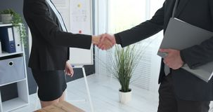 Business people shaking hands at office. Midsection of businessman and businesswoman shaking hands at office stock footage