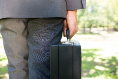 Midsection of businessman carrying briefcase Stock Photo