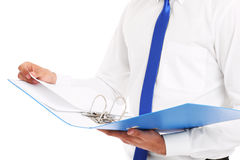 Midsection of a businessman with documents Stock Photography