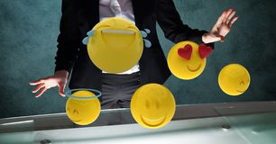 Midsection of businessman with emojis. Digital composite of Midsection of businessman with emojis Royalty Free Stock Photos