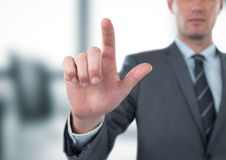 Midsection of businessman gesturing in office Royalty Free Stock Images
