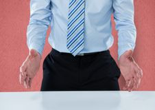 Midsection of businessman gesturing at table Stock Photo
