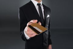Midsection of businessman giving credit card Stock Photography