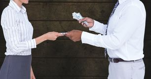 Midsection of businessman giving money to colleague representing corruption concept royalty free stock images