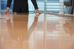 Midsection Of Businessman With Hands On Conference Table Royalty Free Stock Images