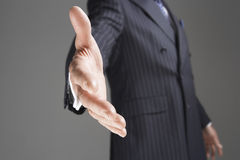 Midsection Of Businessman Offering Hand Royalty Free Stock Photo