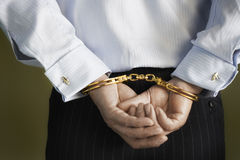 Midsection Of Businessman's Hands Cuffed Behind Back Royalty Free Stock Photos
