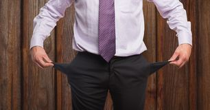 Midsection of businessman showing empty pockets. Digital composite of Midsection of businessman showing empty pockets Stock Images