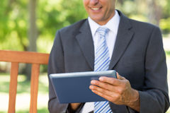 Midsection of businessman using digital tablet Royalty Free Stock Photo