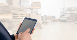 Midsection businessman using digital tablet in warehouse Stock Image