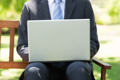 Midsection of businessman using laptop Stock Image
