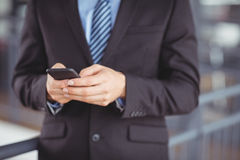Midsection of businessman using mobile phone Stock Photos