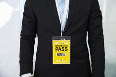 Midsection of businessman wearing backstage pass Stock Image