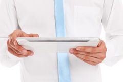 Midsection of a businessman working on tablet Stock Photos