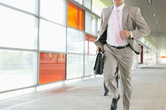 Midsection of businessmen rushing on railroad platform Royalty Free Stock Images