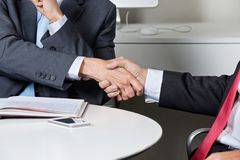 Midsection Of Businessmen Shaking Hands Royalty Free Stock Images