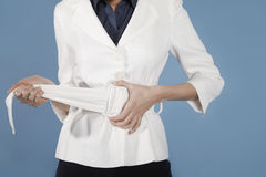 Midsection Of Businesswoman Adjusting Belt Stock Photos