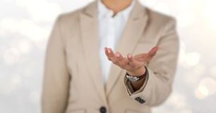 Midsection of businesswoman offering hand stock photos