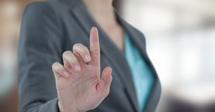 Midsection of businesswoman touching futuristic screen Royalty Free Stock Image