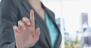 Midsection of businesswoman touching imaginary screen Royalty Free Stock Photo