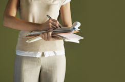 Midsection Of Businesswoman Writing In Notepad Royalty Free Stock Photography