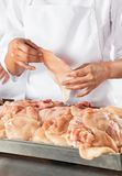 Midsection Of Butcher Holding Meat Piece Stock Images