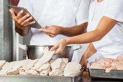 Midsection Of Butchers Working In Shop Royalty Free Stock Photography