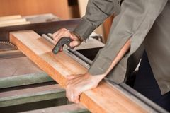 Midsection Of Carpenter Cutting Wood With Tablesaw Stock Image