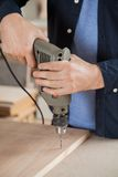 Midsection Of Carpenter Drilling Wood Stock Images