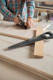 Midsection Of Carpenter Using Planer At Workbench Stock Photography