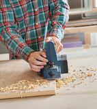 Midsection Of Carpenter Working With Electric Royalty Free Stock Images