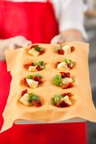 Midsection Of Chef Holding Tray With Stuffed Royalty Free Stock Images