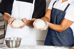 Chefs Presenting Dough In Kitchen Stock Photos