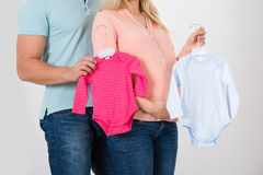 Midsection Of Couple Holding Baby Clothing Royalty Free Stock Photo