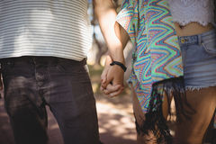 Midsection of couple holding hands Royalty Free Stock Images