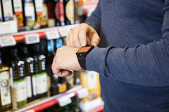 Midsection Of Customer Touching Smartwatch's Screen In Grocery Royalty Free Stock Image