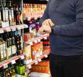 Midsection Of Customer Using Smartwatch In Grocery Store Stock Image
