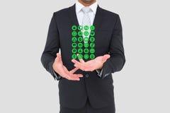 Midsection dell'uomo d'affari con le icone mediche Immagini Stock Libere da Diritti