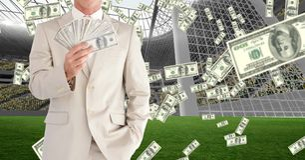 Midsection die van zakenman geld tonen bij voetbalstadion die corruptie vertegenwoordigen royalty-vrije stock foto's