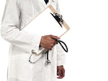 Midsection of a doctor holding stethoscope and clipboard Stock Image