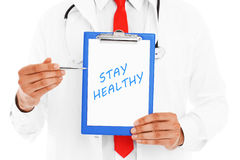 Midsection of a doctor pointing at stay healthy inscription Stock Photo