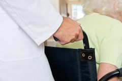 Midsection Of Doctor With Senior Patient Royalty Free Stock Photos