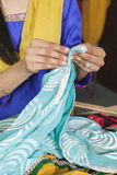Midsection of dressmaker working on a sari Stock Photography