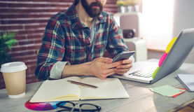 Midsection of editor using smartphone Royalty Free Stock Photography
