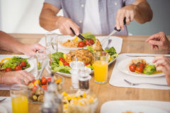 Midsection of family having breakfast Royalty Free Stock Images