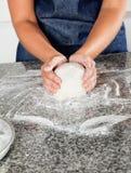 Female Chef Kneading Dough Royalty Free Stock Photos