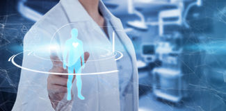 Composite image of midsection of female doctor using digital screen royalty free stock photo