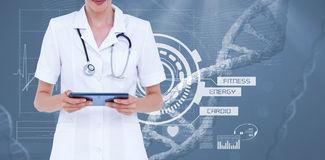 Midsection of female doctor using tablet computer Royalty Free Stock Image
